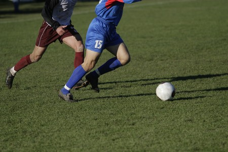 closeup of action of soccer players in the field photo