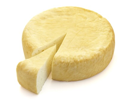 close up of cheese on white background photo