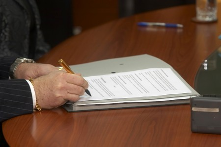 close up of businessman hands signing contract Stock Photo - 4338860