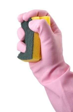 close up of hand in pink rubber gloves holding sponge on white background with path photo
