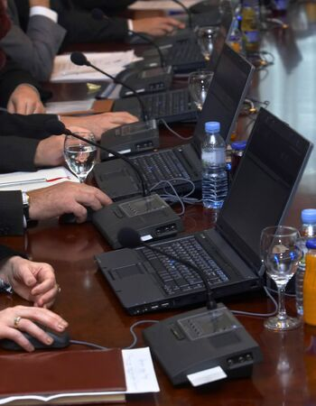 close up of conference meeting laptops and documents photo