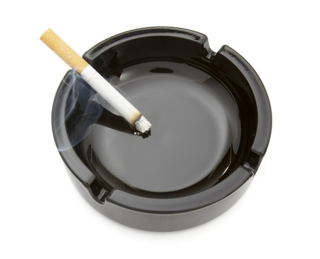 close up of ashtray and cigarettes on white background photo