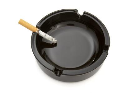 close up of ashtray and cigarettes on white background Stock Photo - 4347127
