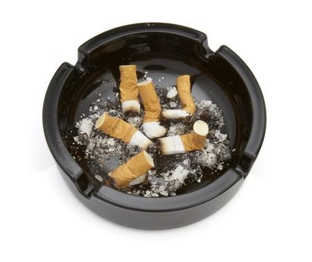 close up of ashtray and cigarettes on white background Stock Photo - 4347196