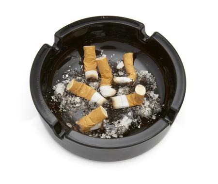 close up of ashtray and cigarettes on white background Stock Photo - 4347196