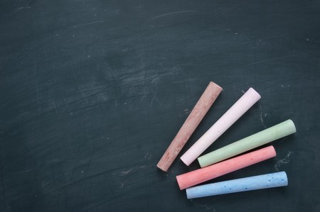 close up of blackboard and color chalks in classroom Stock Photo - 4347214