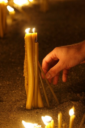 man hand lighting candles  in a church Stock Photo - 4347176