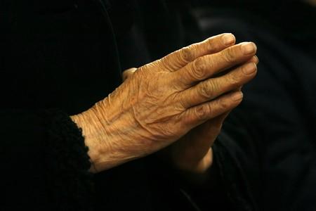 enlightening: close up of woman hands prayer in a church