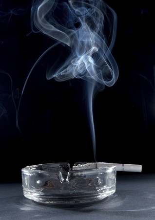 close up of ashtray and burning cigarette with smoke Stock Photo - 4347202