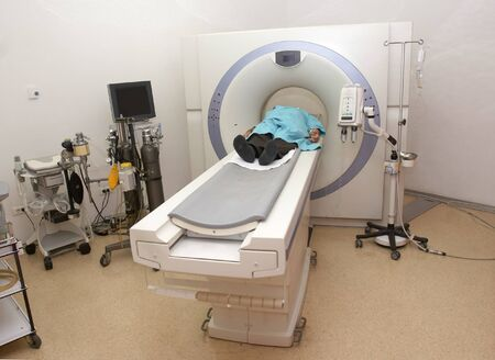 axial: patient lying down and doing ct scan in hospital Stock Photo