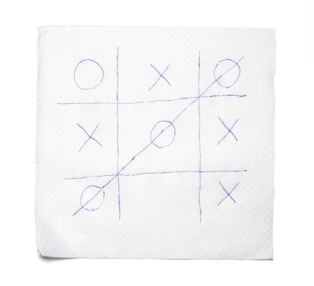 close up of napkin and tic tac toe game on white background Stock Photo - 4362612