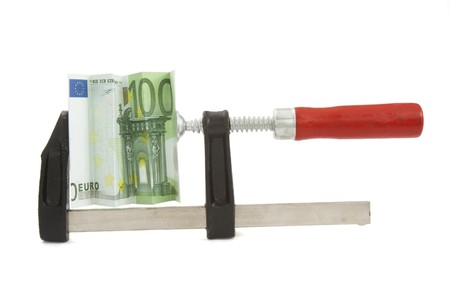 object oppression: close up of clamp and squeezed euro on white background