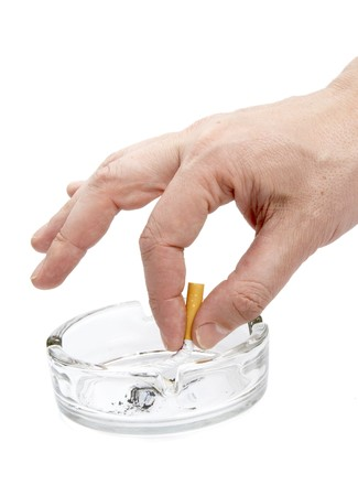 close up of ashtray,cigarettes and hand on white background photo