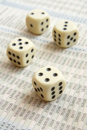 stock quotations: close up of stock market numbers  in papers and dice