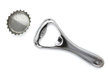 bottle cap opener: close up of bottle opener and cap on white background Stock Photo