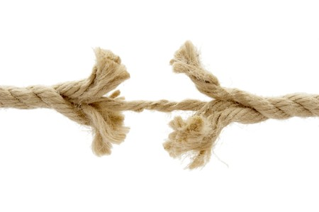frayed: close up of rope section connected by thread  on white background