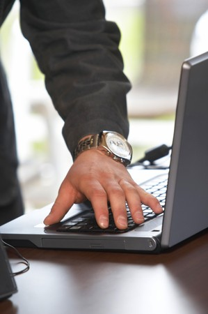 close up of man hands typing on notebook in office with copy space Stock Photo - 4362710