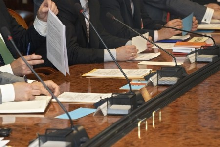 panel: close up of conference meeting businessmen hands