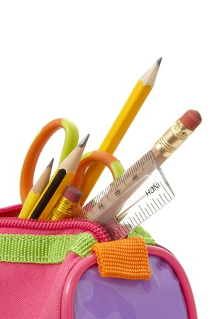 close up of school supplies in pencil case  on white background photo