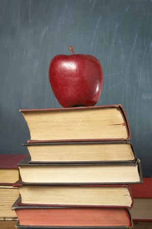 close up of books, apple and blackboard in classroom Stock Photo - 4383265