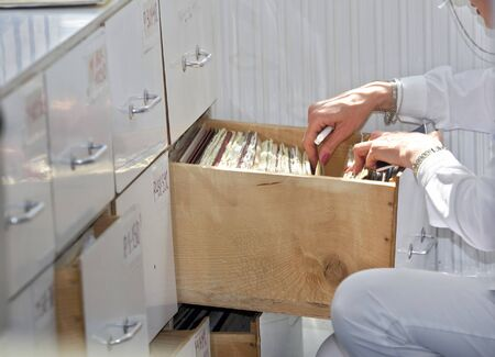 woman lookingin file drawer in hospital photo