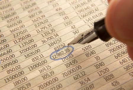 quotations: close up of stock market numbers and fountain pen  Stock Photo