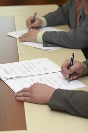 close up of businessmen hands signing contract Stock Photo - 4383283