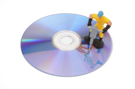 close up of cd failure and toy worker on white background with path photo