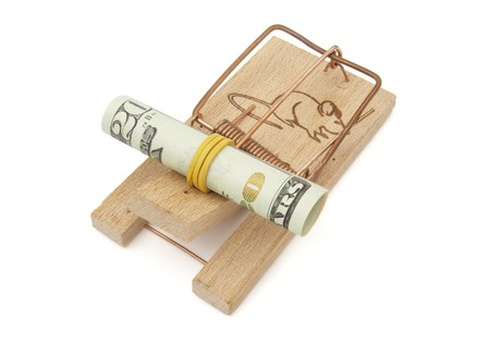 booby: close up of mousetrap and dollars on white background with path Stock Photo