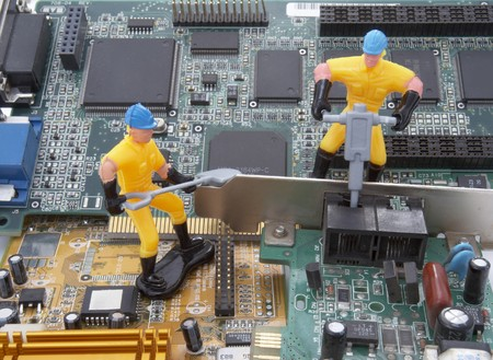 close up of computer parts and toy workers photo