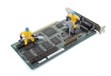 close up of computer parts and toy workers on white background Stock Photo - 4417812