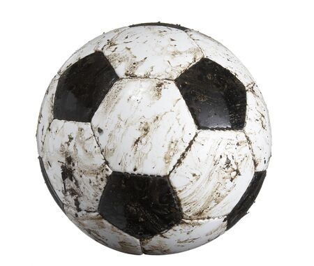 closeup of dirty soccer ball on white background
