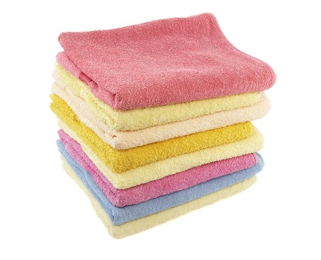 heaped: close up of stack of colorful towels on white background