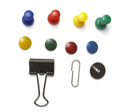 office appliances: close up of various push pins on white background