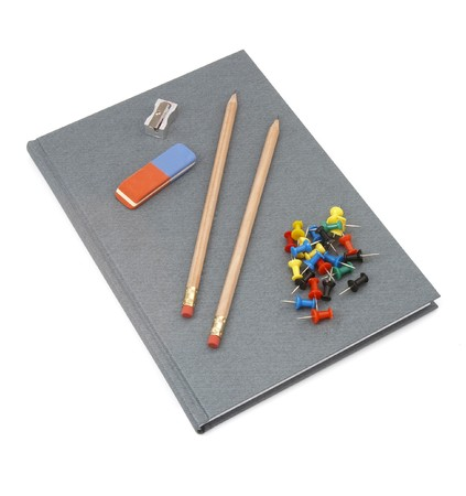 close up of notebook, pencils, sharpener, eraser and push pins on white background Stock Photo - 4417888
