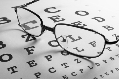 health symbols metaphors: close up of glasses and snellen chart