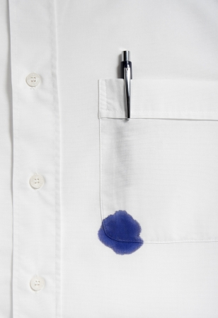 blue shirt: close up of businessman ruined shirt and and leaking pen Stock Photo