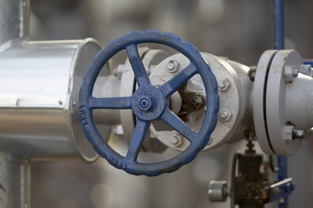 close up of industrial pipes of oil industry production photo