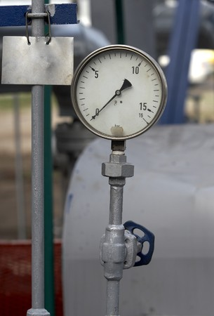 close up of industrial pipes and measurer of compression photo