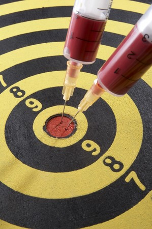 close up of dartboard and needles Stock Photo