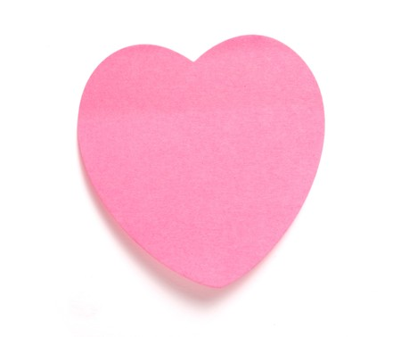 annotation: close up ofheart shaped reminder on white background