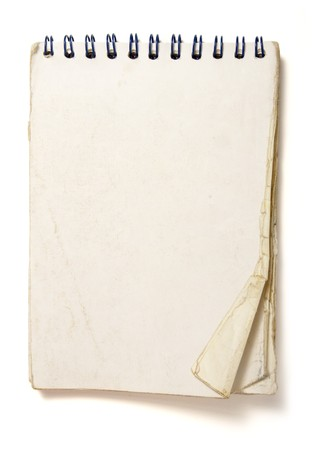 old used notebook on white background photo