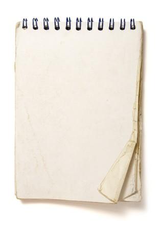 viejo cuaderno utilizado en el fondo blanco