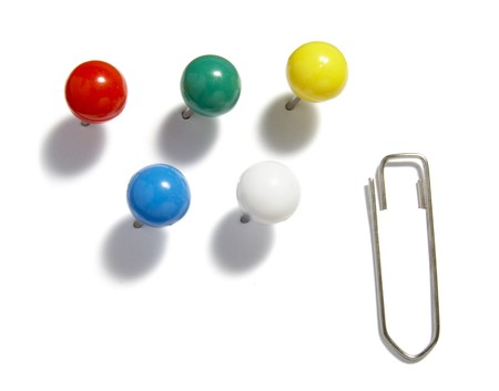 drawing pins: close up of various pushpins  on white background
