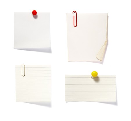 drawing pin: close up of postit reminders on white background . each one is in cameras full resolution