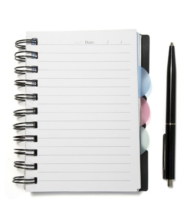 lined up: close up of notebook and pencil on white background Stock Photo