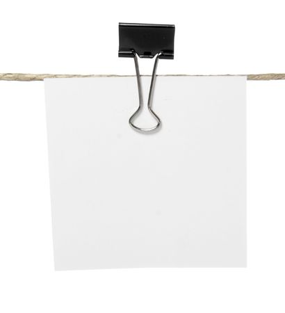 close up of postit reminders on a clothesline on white background photo