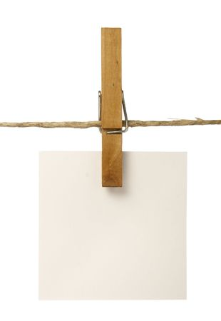 clothespins: close up of postit reminders and clothespins attached to a rope on white background
