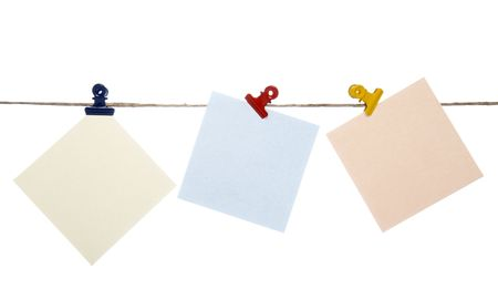 close up of postit reminders on a clothesline on white background Stock Photo - 4603162