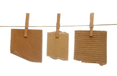 close up of postit reminders and clothespins attached to a rope on white background photo